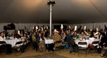Rotating image:  Everyone raising their paddles high during the Paddles Up portion of the live auction