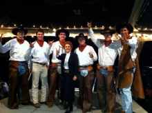 Auctioneer Gayle Stallings with the University of Texas Cowboys as bid spotters